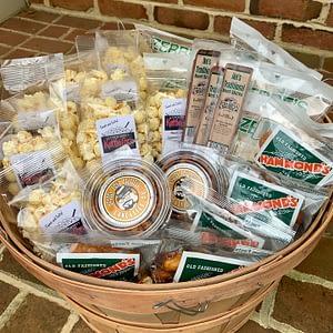 Bushel basket snacks of popcorn, flavored pretzel pieces, beef sticks, chips and pretzels.
