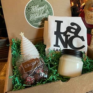 Classic Lancaster Holiday gift box of chocolate candies, candle, Lancaster towel and porcelain tree