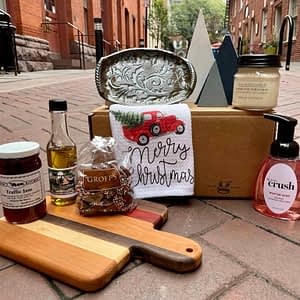 Lancaster Christmas box with bread board, jam, olive oil, chocolates, ceramic dish, soap and candle